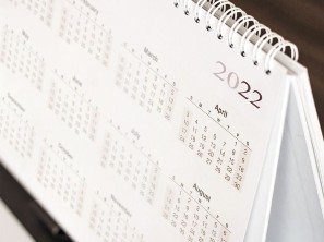 A 2020 calendar sitting next to a coffee cup
